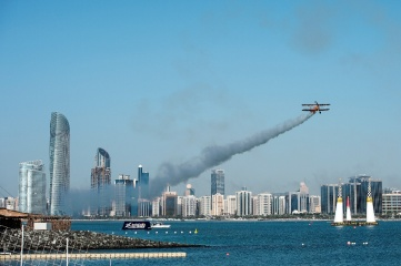Brietling Wing Walkers perform during a side act prior to the finals of the first stage of the Red Bull Air Race World Championships in Abu Dhabi, UAE in March 2016