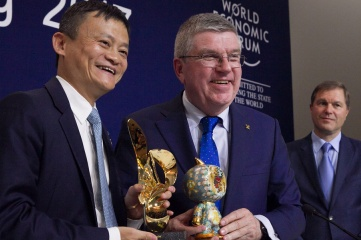 Alibaba CEO Jack Ma and IOC President Thomas Bach at the signing ceremony in Davos