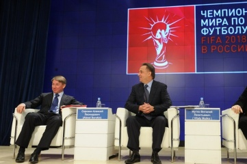 Alexey Sorokin (left) under the newly unveiled 2018 FIFA World Cup Official Emblem