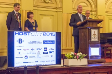 Sir Craig Reedie addressing Host City delegates at the Glasgow City Chambers in November 2015 (L-R: John F MacLeod, Lord Dean of Guild of the Merchants House of Glasgow; The Rt Hon The Lord Provost of Glasgow, Councillor Sadie Docherty; Sir Craig Reedie; Cavendish Group Chairman, Koos Tesselaar