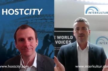 Hans-Robert Dapprich Director Communications, Marketing and Sales, INTERKULTUR speaking with Host City Director Ben Avison