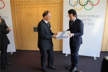 Liu Peng, Chairman of the Chinese Olympic Committee hands over Beijing 2022's official guarantees to Christophe Dubi, IOC Olympic Games Executive Director (Photo Copyright: ZHANG Miao, Xinhua News Agency)