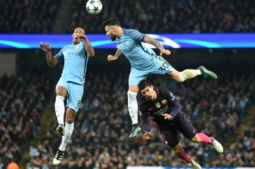 Fernando, Nicolas Otamendi and Luis Suarez pictured during the UEFA Champions League Group C game between Manchester City and FC Barcelona at Etihad Stadium in November 2016 (Photo: CosminIftode / Shutterstock.com)
