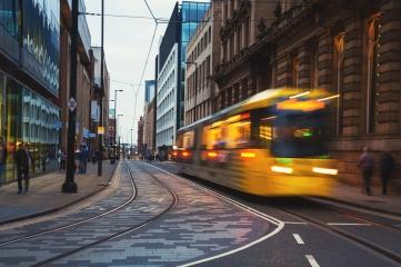 Light rail Metrolink tram in the city center of Manchester
