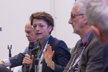 Sarah Lewis speaking at Host City 2015 (between Slovenian NOC President Janez Kocijancic and UCI President Brian Cookson)