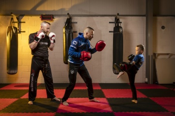 WKC Scotland President Malcolm Evans (centre) training Lachlan Blaikie (7) and Lindsay Ross (47), who are among the youngest and oldest competitors in this year's Aberdeen Open. Photo Credit: Ross Johnson/Newsline Media