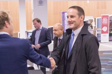 Host City and Cavendish Group CEO Matthew Astill (left) congratulating David Grevemberg CBE at Host City 2015