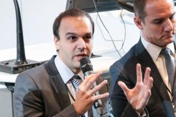 Itay Ingber (left) speaking at Host City 2016, with David Grevemberg CBE (right)