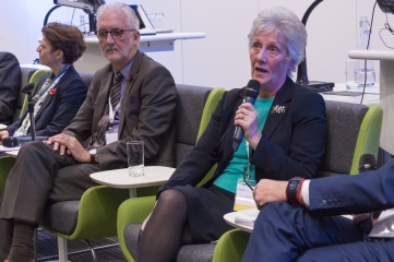 Louise Martin CBE speaking at Host City conference, with UCI President Brian Cookson and FIS Secretary General Sarah Lewis