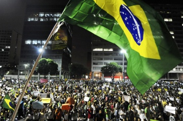 Demonstrators marching to Rio de Janeiro's city hall during last year's Confederations Cup