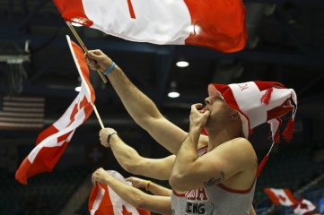 Team Canada fans wave Canadian flags at the Ford World Women's Curling Championship March 19, 2014 in Saint John, Canada (Photo: Jamie Roach / Shutterstock)