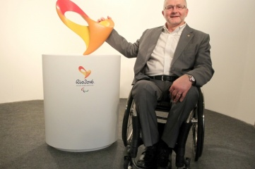 Sir Philip Craven, IPC President, with the Rio 2016 Paralympic Games emblem (Photo: Rio 2016)